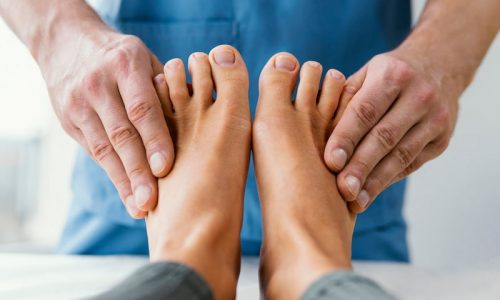 front-view-of-male-osteopathic-therapist-checking-female-patient-s-toes (1)